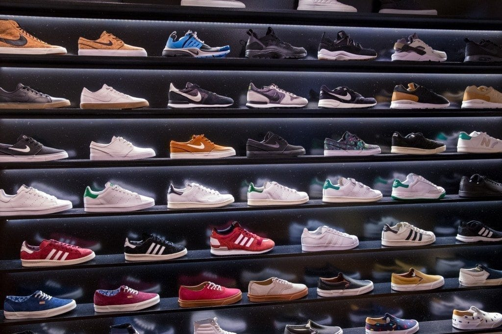 Sneakers on a wall in a store