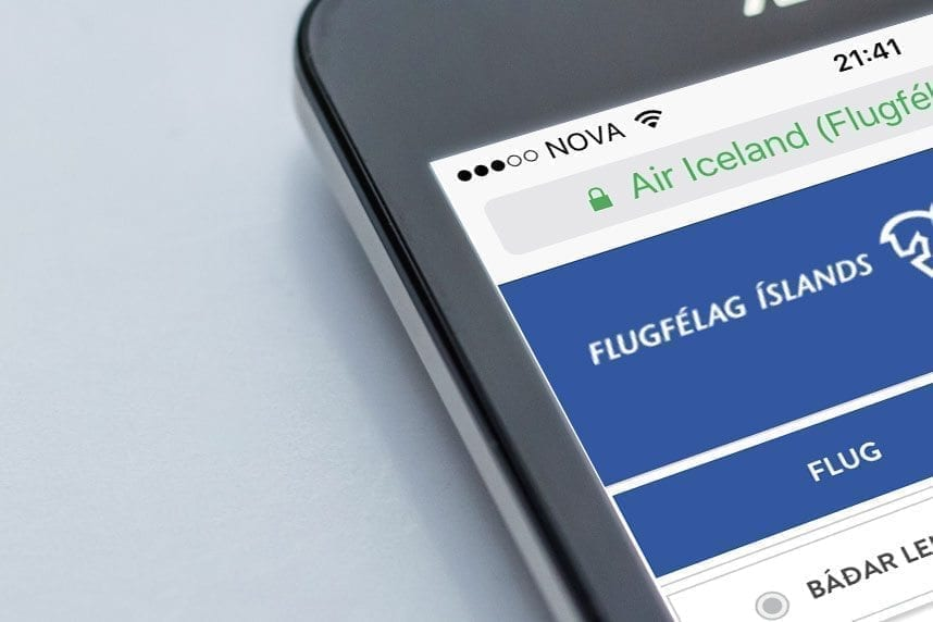 A mobile phone displaying Flugfélag Íslands website